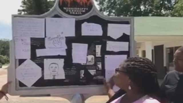 St. Louis teens leave messages of hope on a vandalized Civil Rights memorial. Credit: KMOV