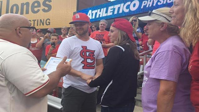 Tyson & Alyssa Baker getting married in section 103 of Busch Stadium (Credit: Donna Shores O'Day)