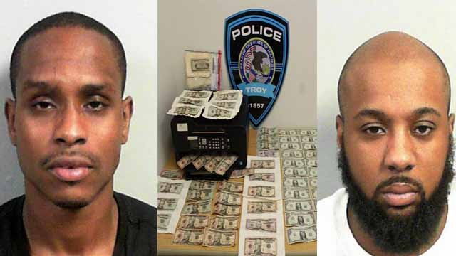 Two New York men are in custody after being accused of manufacturing counterfeit money at the Red Roof Inn in Troy, Ill. (Credit: Troy Police Department)