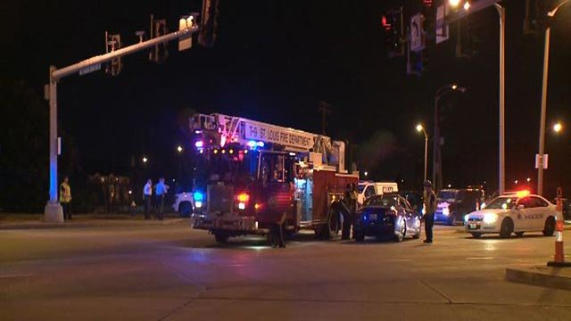 Emergency crews at Broadway and Cole after a woman's car was sideswiped (Credit: KMOV)