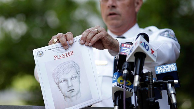 West Goshen Police Chief Joseph Gleason holds a sketch of a suspected road rage shooter during a news conference outside police headquarters, Friday, June 30, 2017, in West Goshen, Pa. (AP Images)
