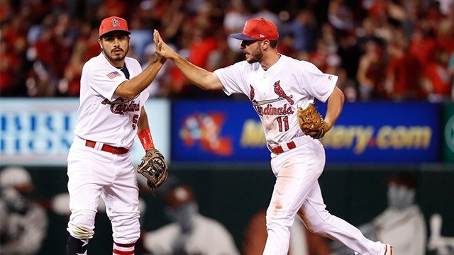St. Louis Cardinals' Alex Mejia, left, and teammate Paul DeJong celebrate following a baseball game against the Washington Nationals Saturday, July 1, 2017, in St. Louis. The Cardinals won 2-1. (AP Photo/Jeff Roberson)