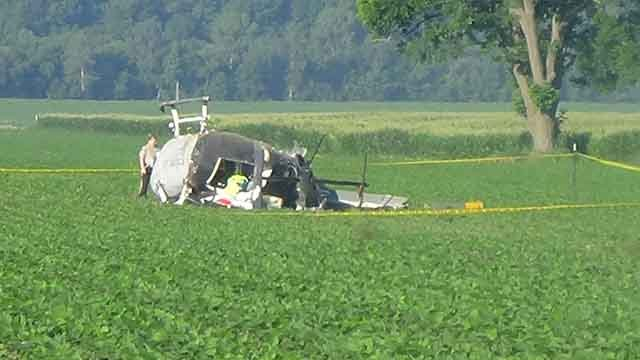 Crews at the scene of a helicopter crash in Perry County on Sunday, July 2, 2017 (Credit: Jody Odem)