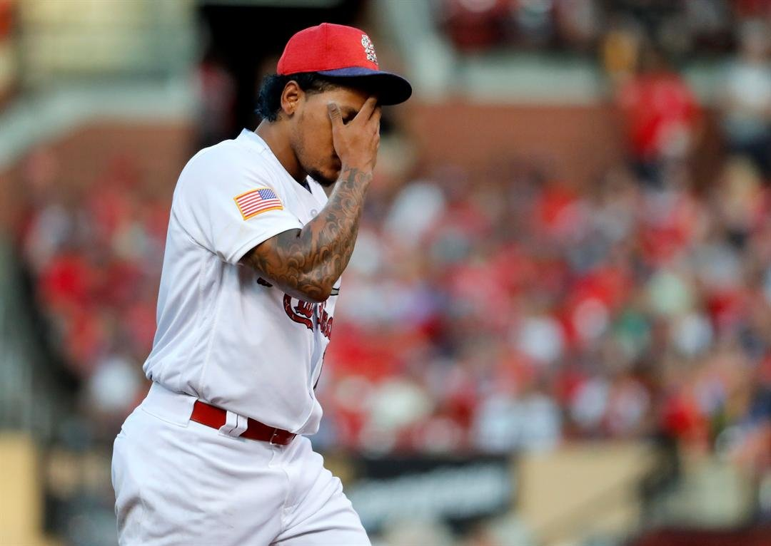 St. Louis Cardinals starting pitcher Carlos Martinez rubs his face after giving up a two-run home run to Washington Nationals' Bryce Harper during the third inning of a baseball game Sunday, July 2, 2017, in St. Louis. (AP Photo/Jeff Roberson)