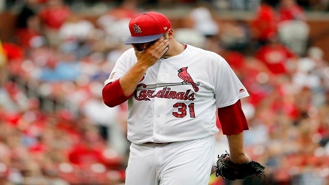 St. Louis Cardinals starting pitcher Lance Lynn rubs his face as he walks off the field after being removed during the sixth inning of a baseball game against the Miami Marlins, Tuesday, July 4, 2017, in St. Louis. (AP Photo/Jeff Roberson)