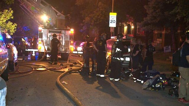 Firefighters outside a vacant house on Pennsylvania following an overnight fire (Credit: KMOV)