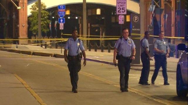 Police on LeonorK. Sullivan near  Martin Luther King Drive after a triple shooting Wednesday (Credit: KMOV)