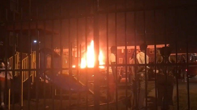 While a dumpster fire burned in South City, gunshots were fired causing bystanders to run and duck for cover. (Credit: KMOV)