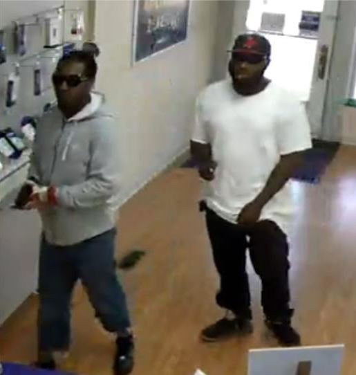 The St. Louis Metropolitan Police Department is searching for two suspects wanted for three armed robberies, which occurred at different Metro PCS stores. (Credit: St. Louis Metropolitan Police Department)