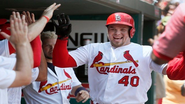 St. Louis Cardinals' Luke Voit is congratulated by teammates after hitting a solo home run during the second inning of a baseball game against the Miami Marlins Thursday, July 6, 2017, in St. Louis. (AP Photo/Jeff Roberson)