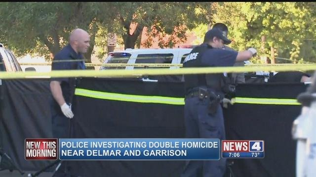 St. Louis police investigate the scene of a double homicide at Delmar and Garrison on Saturday, July 8, 2017 (Credit: KMOV)
