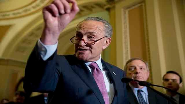 Senate Minority Leader Sen. Chuck Schumer of N.Y. accompanied by Senate Minority Whip Richard Durbin of Ill., right, speaks to reporters after GOP leadership announce they are delaying a vote on the Republican health care bill, at the Capitol in Washingto