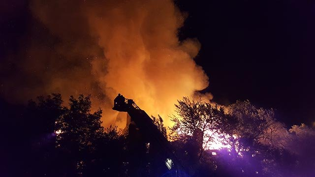 Firefighters on the scene of the Mullanphy and Helen Street fire Wednesday morning (Credit: Brian Howe / KMOV)