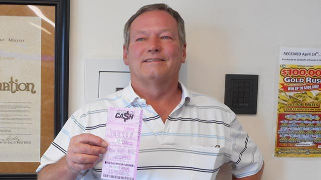 Steve Neal & his $50,000 Missouri Lottery ticket (Credit: Mo. Lottery)