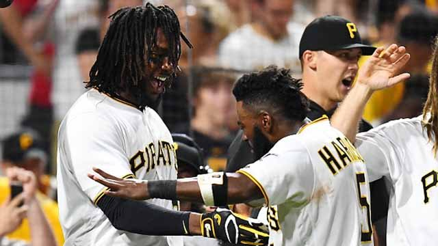 Josh Bell #55 of the Pittsburgh Pirates celebrates his three run home run with Josh Harrison #5 during the ninth inning against the St. Louis Cardinals at PNC Park on July 14, 2017 in Pittsburgh. Pittsburgh won the game 5-2. (Photo by Joe Sargent/Getty)