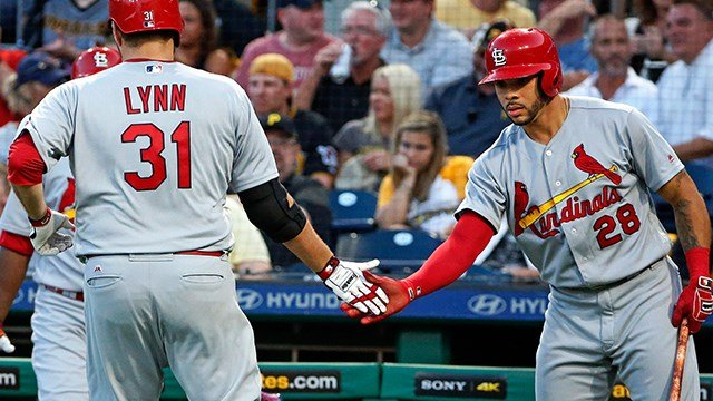 St. Louis Cardinals starting pitcher Lance Lynn (31) is greeted by Tommy Pham (28) after scoring on a single by Matt Carpenter off Pittsburgh Pirates starting pitcher Jameson Taillon in the fifth inning of a baseball game in Pittsburgh. (APImages)