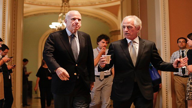 Senate Armed Services Committee Chairman Sen. John McCain, R-Ariz., left, and Senate Foreign Relations Committee Chairman Sen. Bob Corker, R-Tenn. walk on Capitol Hill for a meeting on the revised Republican health care bill. (AP)