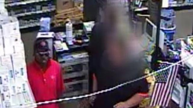 Surveillance photo of Dollar General robbery suspect (Credit: St. Louis County Police)