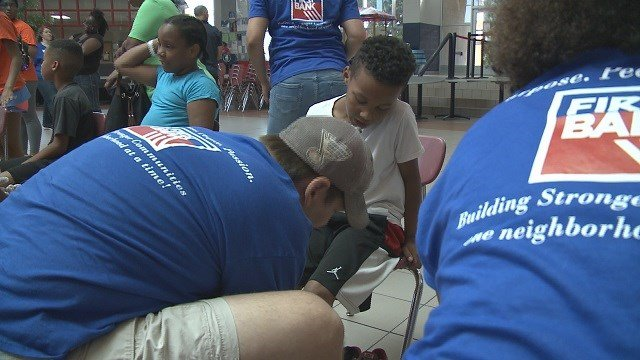 First Bank and Samaritan's Feet partnered together to donate 1,000 pairs of brand new shoes for local children and adults in need. (Credit: KMOV)
