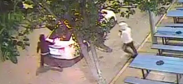 Surveillance photo of suspects robbing a woman on Delmar (Credit: St. Louis Police)