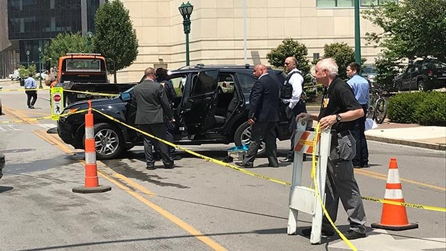 Police near crashed SUV after BJC employee robbed (Credit: Russell Kinsaul / KMOV)