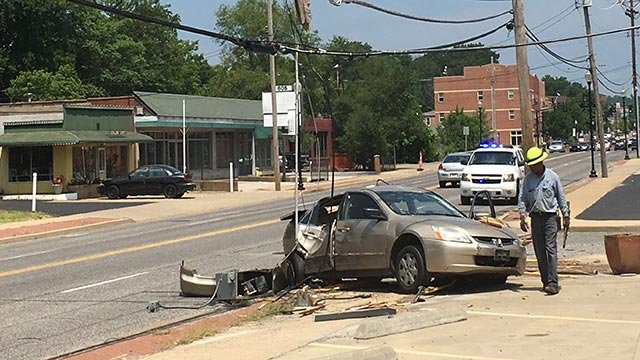 A stolen car crashed into a power pole in Ferguson Wednesday (Credit: KMOV)