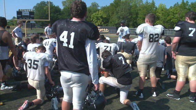 High school football teams are facing health risks as they practice outside during extreme temperatures. (Credit: KMOV)