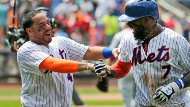 New York Mets' Rene Rivera, left, celebrates with Jose Reyes after Reyes hit a walk-off RBI single during the ninth inning of a baseball game against the St. Louis Cardinals at Citi Field, Thursday, July 20, 2017, in New York.  (AP Photo/Seth Wenig)