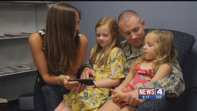 It was special homecoming for Sgt Michael Dye, his wife and daughters. Credit: KMOV