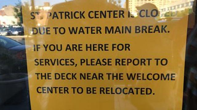 Sign posted on the St. Patrick Center doors announcing the closure (Credit: Justin Andrews / KMOV)