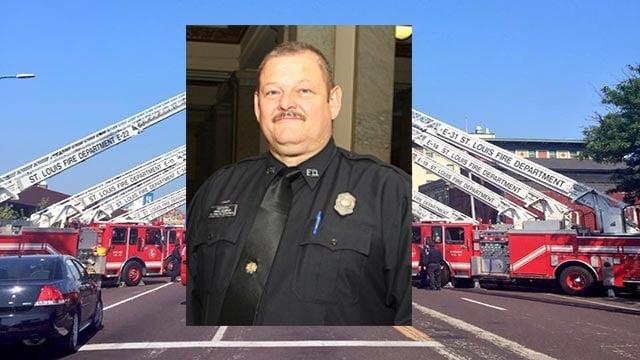 St. Louis Fire Department trucks line the street for fallen Capt. John Kemper (Credit: St. Louis Police / Fire Department)