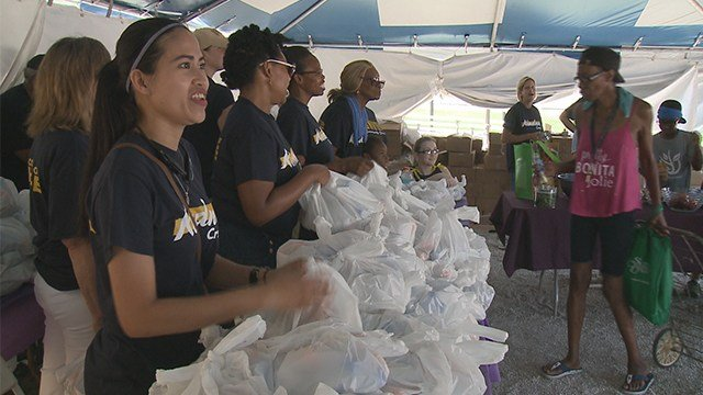 More than 100 area churches came together to provide dozens of free services to people in the area Saturday morning. (Credit: KMOV)