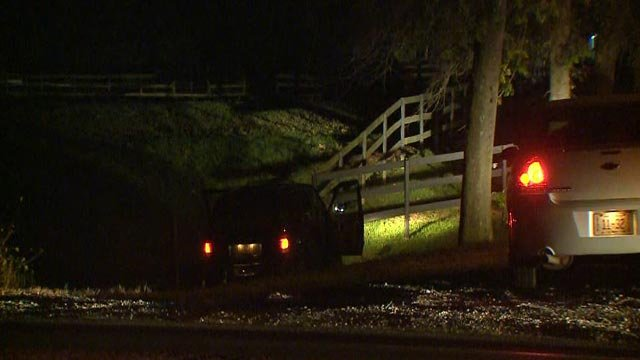 A vehicle carjacked from St. Louis crashed into a fence in Troy, Illinois Monday (Credit: KMOV)