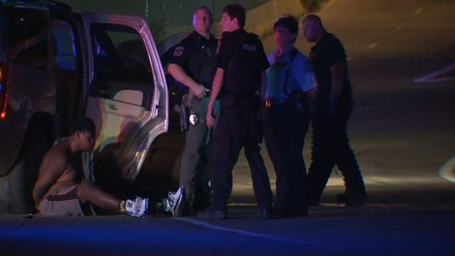 A man in handcuffs after a stolen car crashed Monday morning (Credit: KMOV)