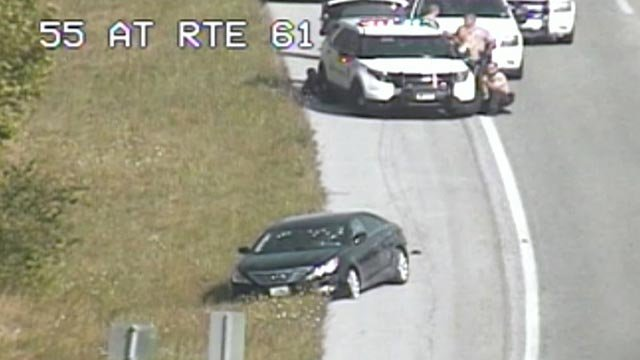 Police behind a suspect vehicle on I-55 at Route 61 (Credit: MoDOT)