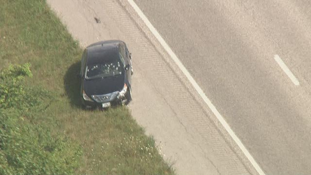Suspect vehicle riddled with bullet holes on I-55 at Route 61 Monday (Credit: Skyzoom4)