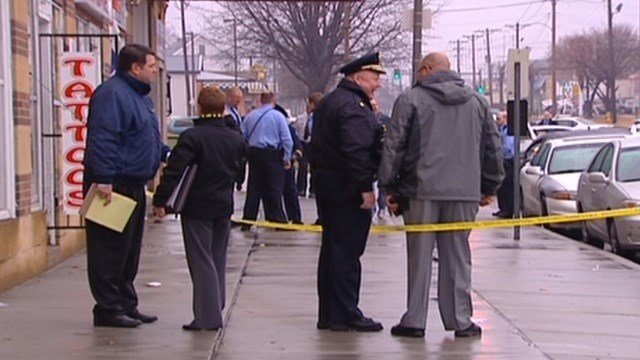 Investigators on scene of the fatal officer-involved shooting in December, 2011. (KMOV)