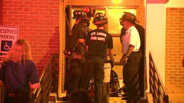 Firefighters at the Orr-Weathers Apartment Wednesday morning (Credit: KMOV)