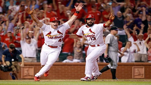 St. Louis Cardinals' Harrison Bader, left, and Matt Carpenter celebrate after Bader scored the game-winning run during the ninth inning of a baseball game against the Colorado Rockies on Tuesday, July 25, 2017, in St. Louis. The Cardinals won 3-2. (AP)