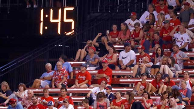 A countdown clock in the outfield reads 1:45 at the end of the fifth inning of a baseball game between the St. Louis Cardinals and the Colorado Rockies on Tuesday, July 25, 2017, in St. Louis. (AP Photo/Jeff Roberson)