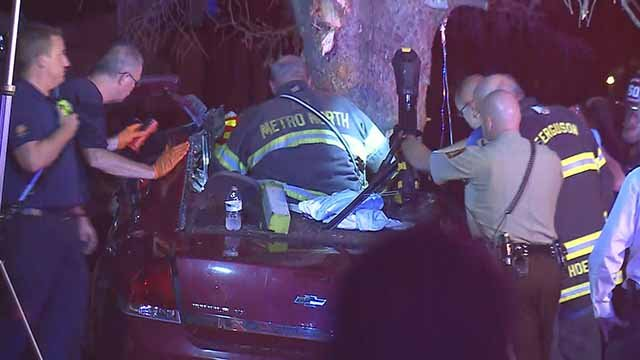 The driver of a car died and three others were injured when a car crashed into a tree near Ferguson on Wednesday night. Credit: KMOV