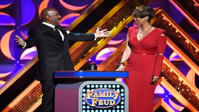 "Steve Harvey, left, and Tyra Banks play ""Family Feud"" at the 42nd annual Daytime Emmy Awards at Warner Bros. Studios (Credit: Chris Pizzello/Invision/AP)"