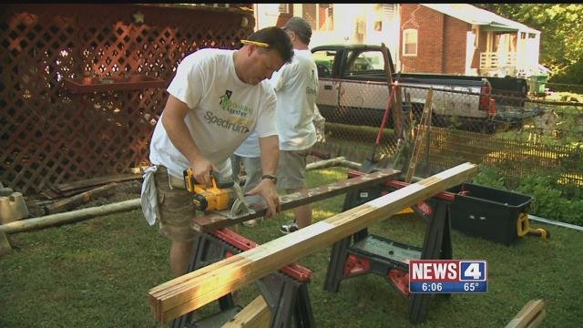 Spectrum employees work to improve homes in North St. Louis on Saturday, July 29, 2017 (Credit: KMOV)