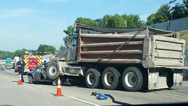 A dump truck collides with a car on Highway 40 at Big Bend Monday (Tim Godfrey, KMOV)