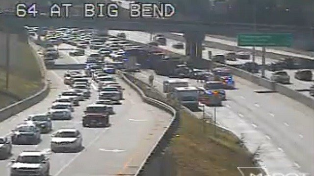 A dump truck collides with a car on Highway 40 at Big Bend Monday