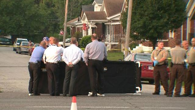 Investigators at Page and Gregan following a Tuesday morning homicide (Credit: KMOV)