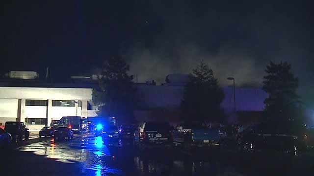 Firefighters are battling a fire inside the Metal Container Corporation facility in Arnold. Credit: KMOV