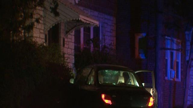 A car crashed into a porch in the 6000 block of West Florissant Wednesday (Credit: KMOV)