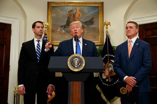 President Donald Trump, flanked by Sen. Tom Cotton, R- Ark., left, and Sen. David Perdue, R-Ga., speaks in the Roosevelt Room of the White House in Washington, Wednesday, Aug. 2, 2017. (AP Photo/Evan Vucci)