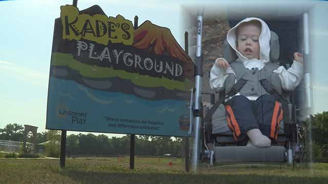 Kade (R) and the playground named after him. Credit: KMOV